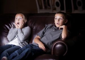Children watching Shocking Television Programming